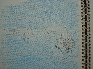空に浮かぶ巨大な白龍の夢