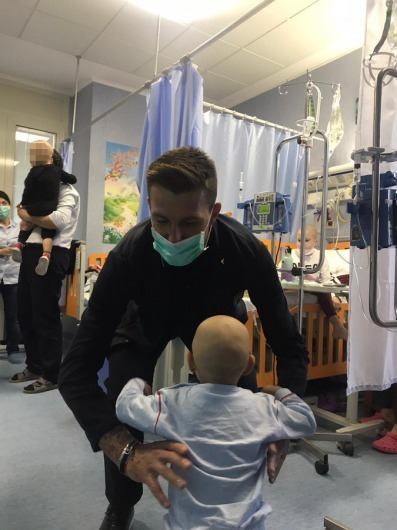 The Italy squad visited a children's hospital in Rome on Thursday and defender Acerbi