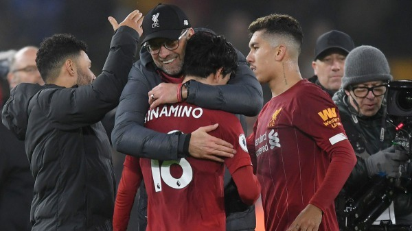 well deserved Klopp hug for your first of many liverpool appearances minamino